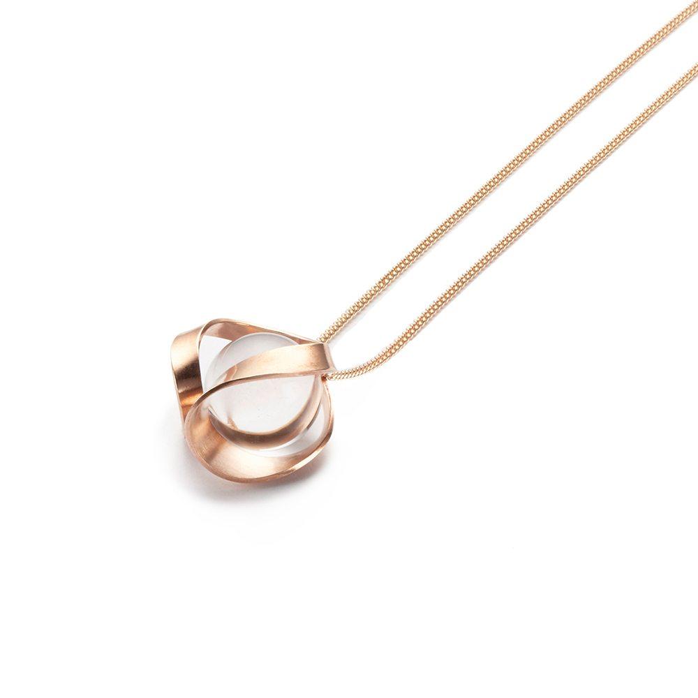 Rose gold and quartz pendant