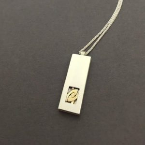 two-tone silver gold remodelled pendant
