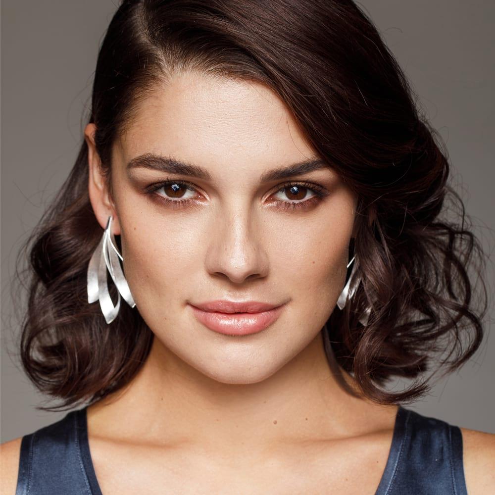 Triple dancing flame earrings on model