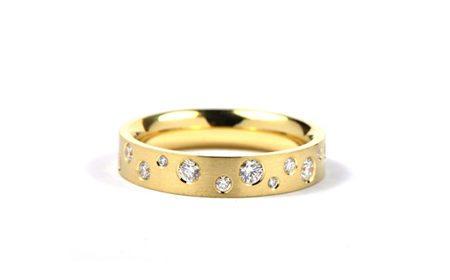 Yellow gold modern women's wedding ring with diamonds