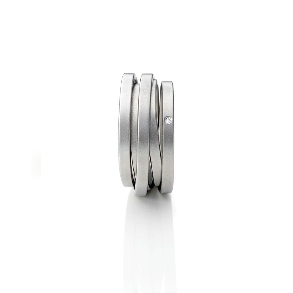 Steel and diamond saturn ring