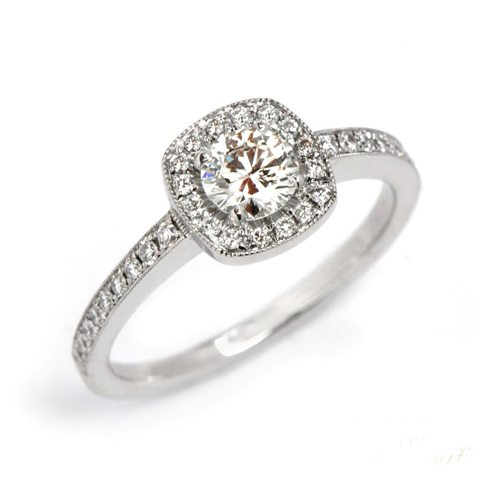vintage diamond halo engagement ring with pave band