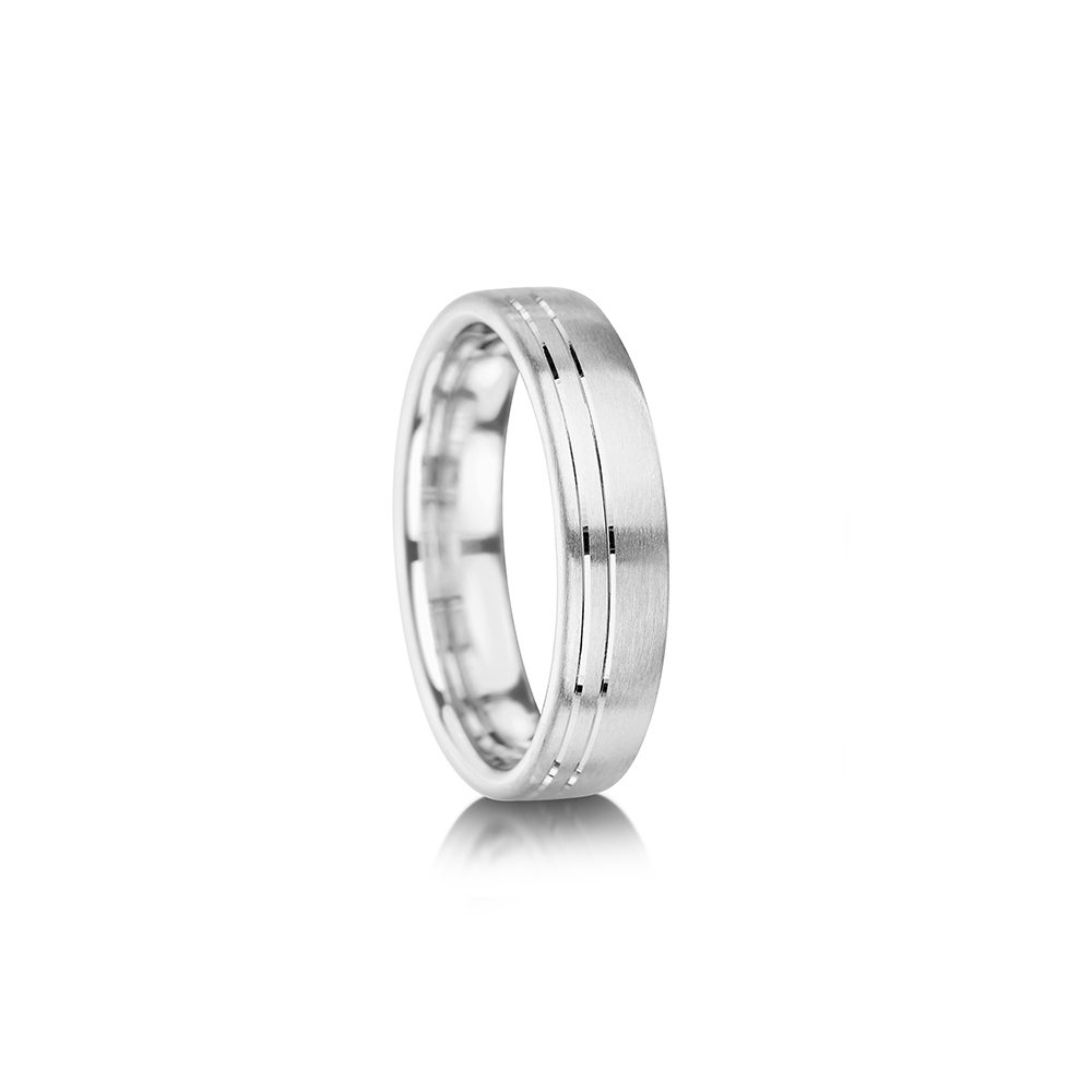Curved wedding ring with offset grooves