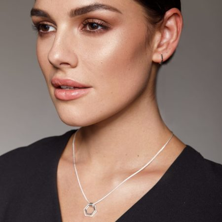Model wearing silver hexagon jewellery