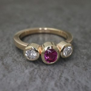 Three Sone Bezel Set Ring