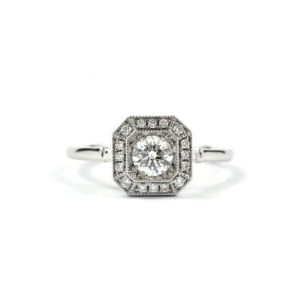 Art Deco style ring in 18ct white gold with round centre diamond with diamond surround in octagonal shape