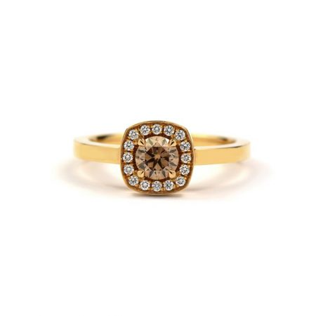 Gold ring with champagne diamond centre stone and diamond surround