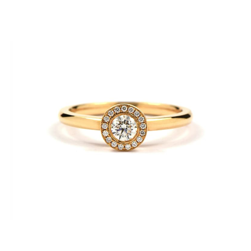 gold ring set with round diamond