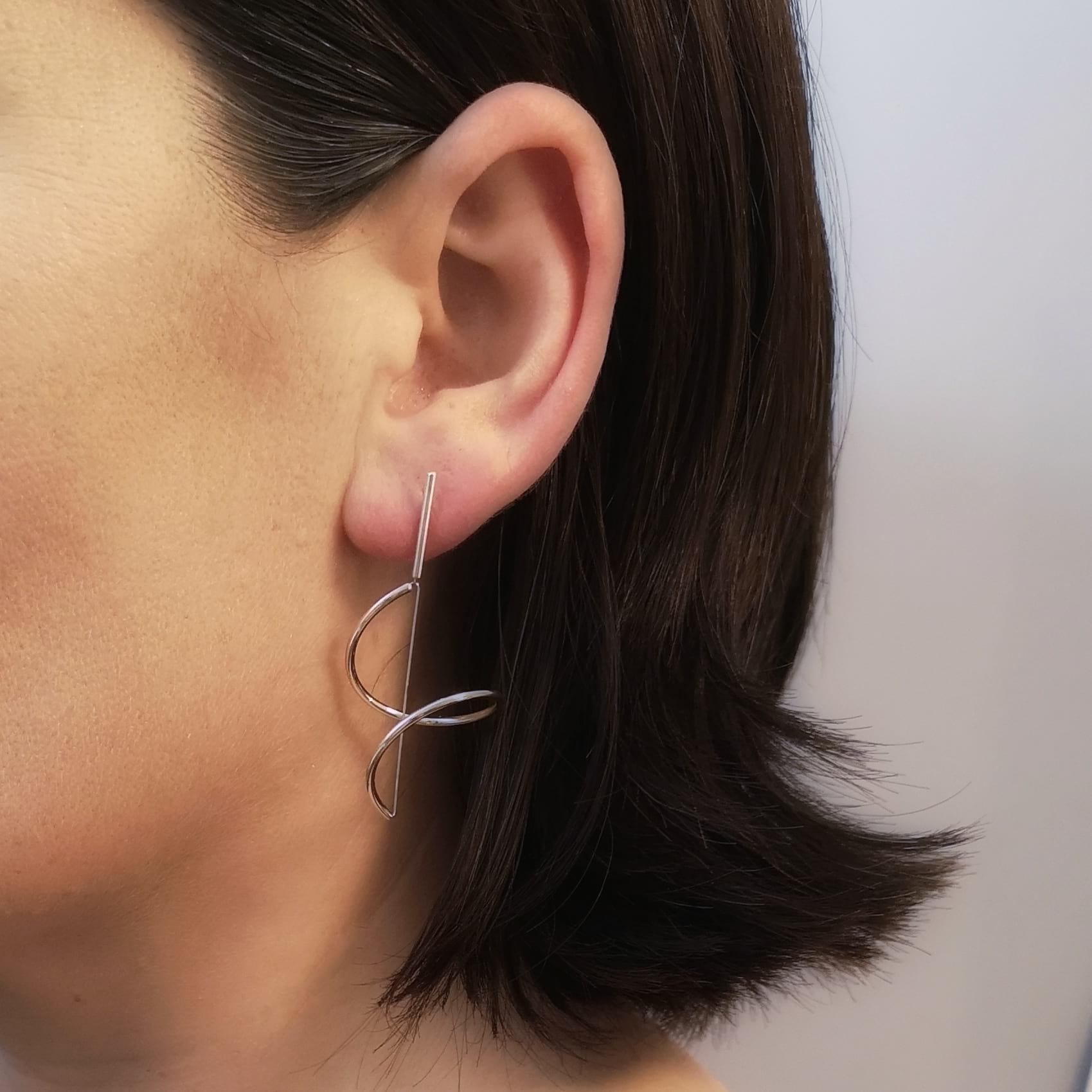 Silver Swirl Earrings on Model